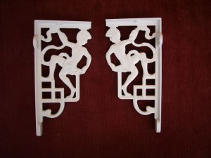 White ornate brackets for high cistern or basin